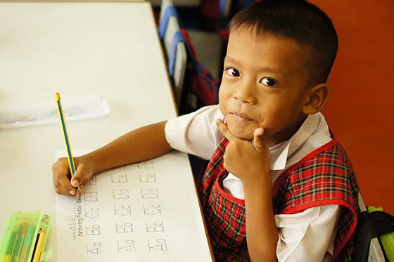One of the adorable kindergarten students you can expect to teach in Thailand