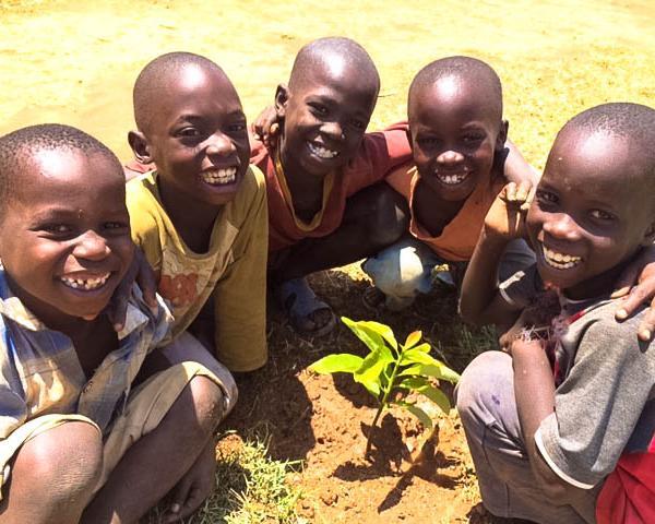 Volunteer helping rural children in Jinja