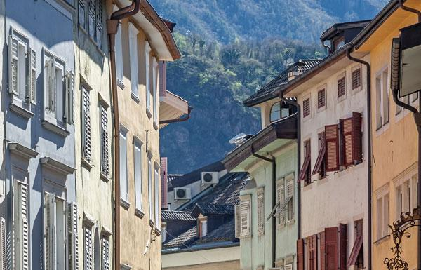 Buildings lining a street in Brixen, Italy