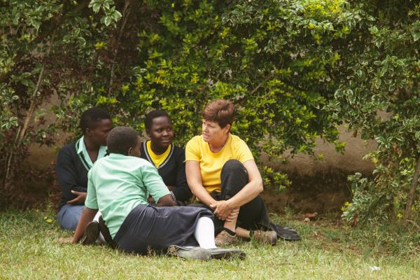 Speaking with students at their school in Uganda, Africa