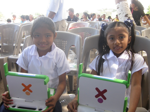Some kids holding their new XO laptops a few minutes after they received them