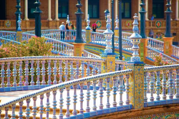 intricate art on columns at the plaza de espana in seville spain