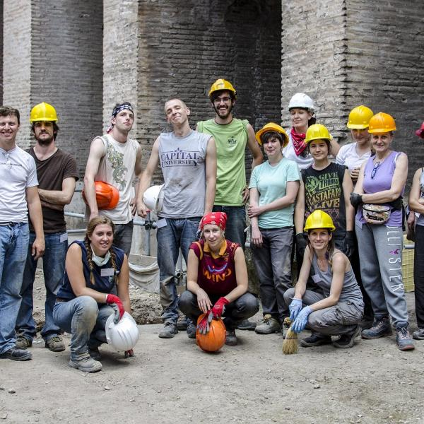 Students dig inside the colosseum