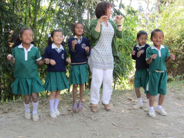 HELP volunteer teaching using games in West Bengal