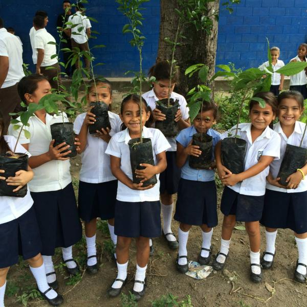 Salvadoran schools girls with their new fruit trees!