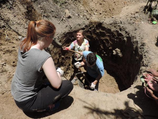 Volunteers building a compost toilet in Nepal