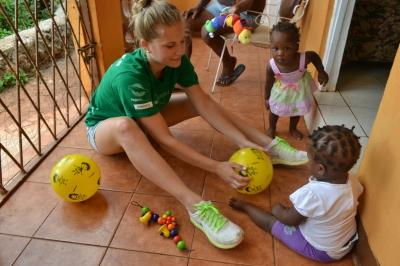 Projects Abroad volunteer with children at Childs Rights Initiative