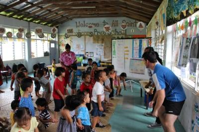 Projects Abroad volunteer leading a stretch with students in Samoa