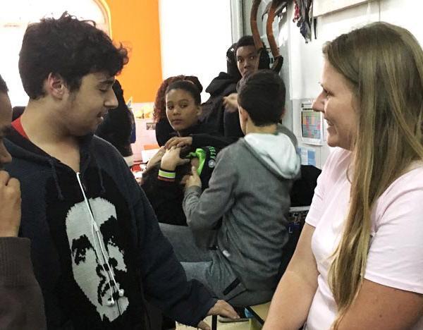 Student talking to a teacher