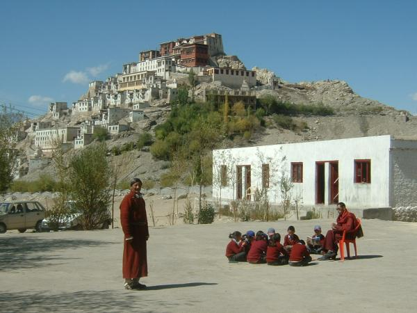 Students sit outside their school in Ladakh