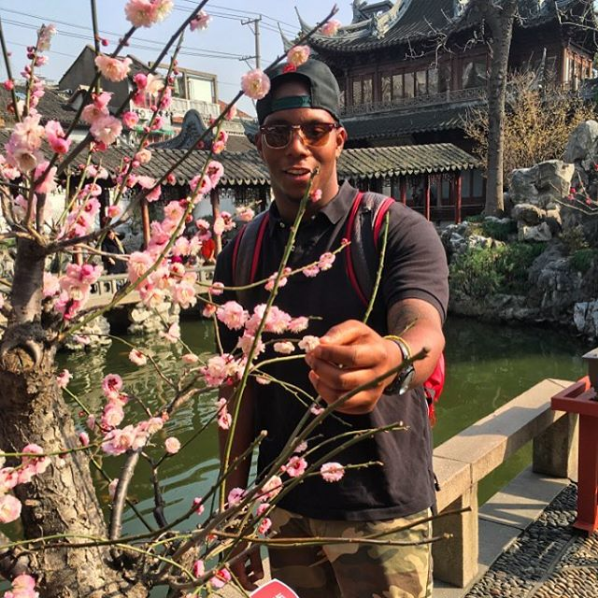Student With Cherry Blossoms