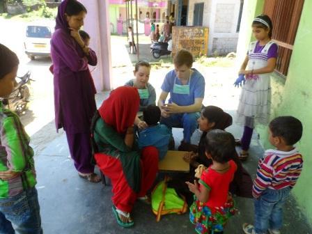 Interns with local children