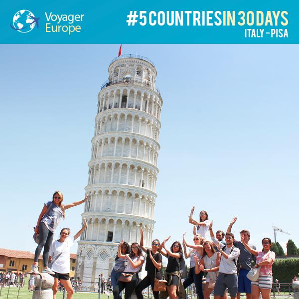 Voyagers posing with the Leaning Tower of Pisa