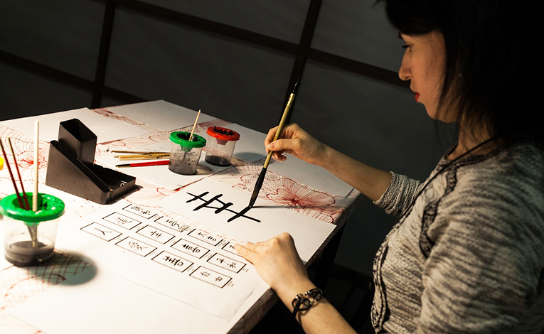 Woman practicing calligraphy