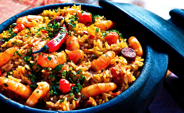 Rice with sausage, seafood, and chiles in a clay pot
