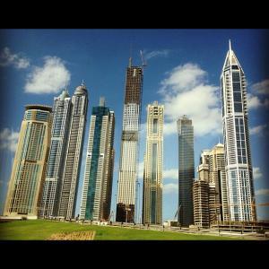 Clouds lingering over a cityscape of Dubai create a futuristic scene.