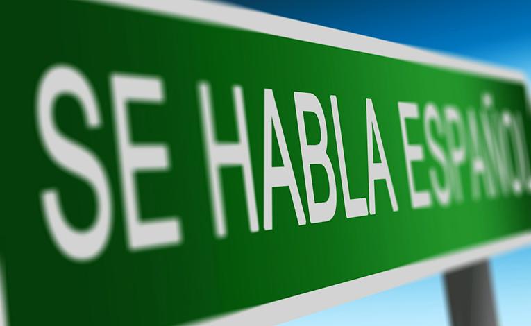 Speak Spanish sign