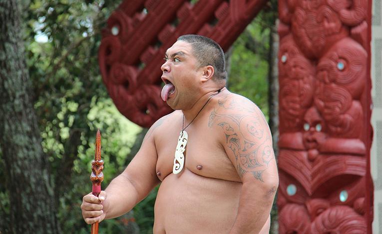 Man performing the Haka at a marae