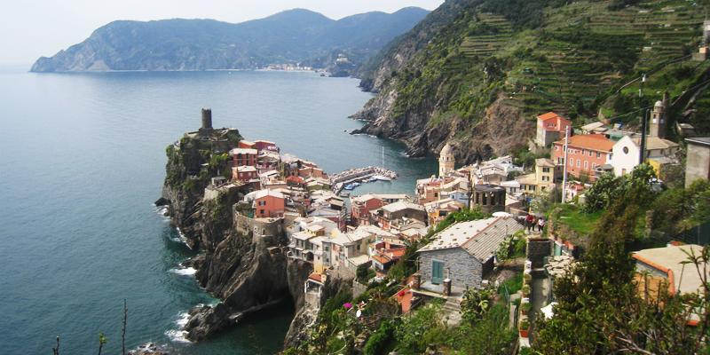 Travel to Europe by Sea and have a pit stop on the Port cities like Cinque Terre, Italy.