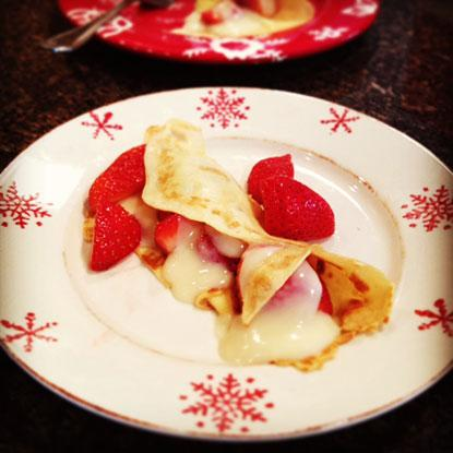 Make your favorite international dishes at home like homemade crepes with pastry cream and fresh strawberries.