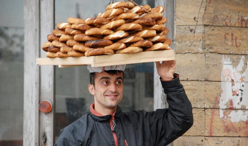 Turkish man carrying bread