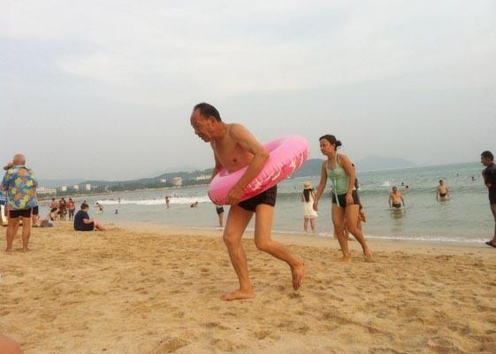 Enjoy people watching on the beaches of Hainan Island
