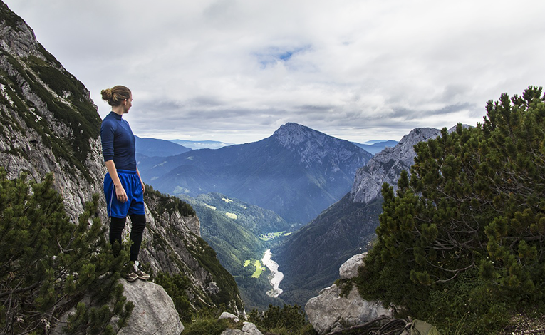woman trekking in the Julian Alps surrounding Slovenia