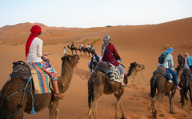Riding camels in Merzouga, Morocco
