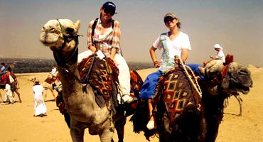 Students camel back riding in Egypt