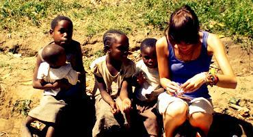 A student interacts with children in Kenya