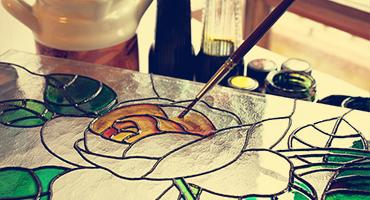Artist painting stained glass