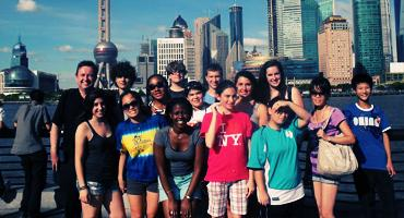 International students pose on the waterfront of Shanghai in China