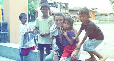 A study abroad student with street children