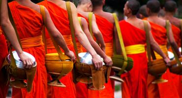 Monks making their way to the local community for the alms giving ceremony.