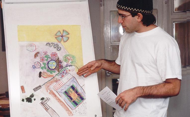 Man presenting an art piece