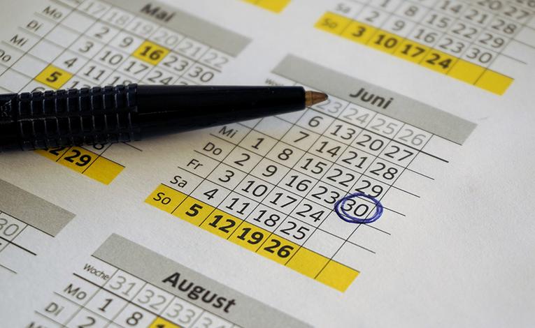 Pen on top of calendar
