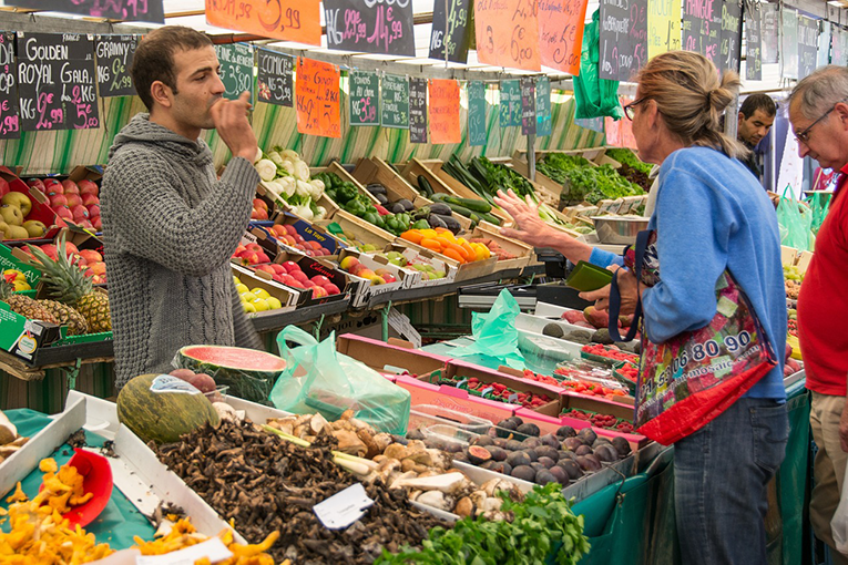 Woman shopping for produce at a market