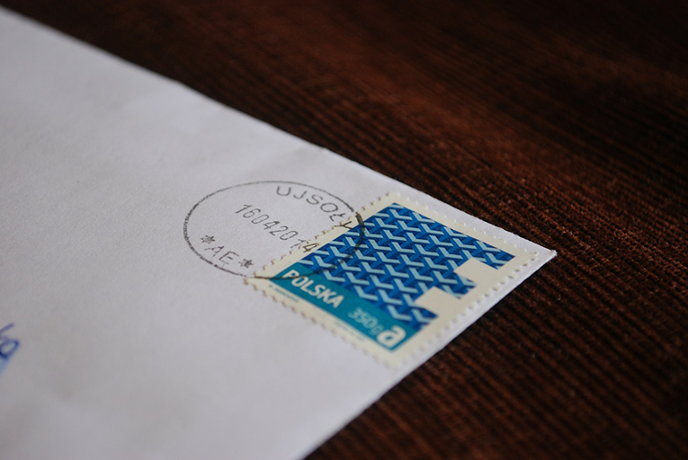 Corner of a letter with blue postage stamp