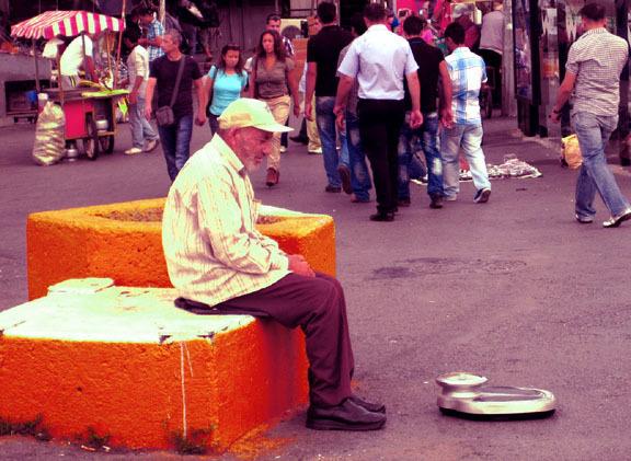 Man sitting on a street in Ankara, Turkey