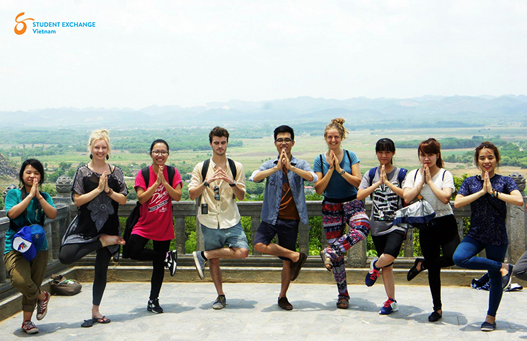 Tourists doing a yoga pose while hiking in Vietnam