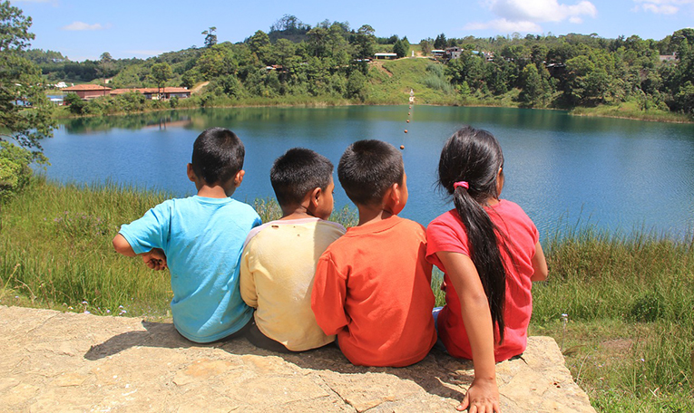Children enjoying the view of a lake in Guatemala