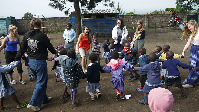 Volunteers with children in Africa