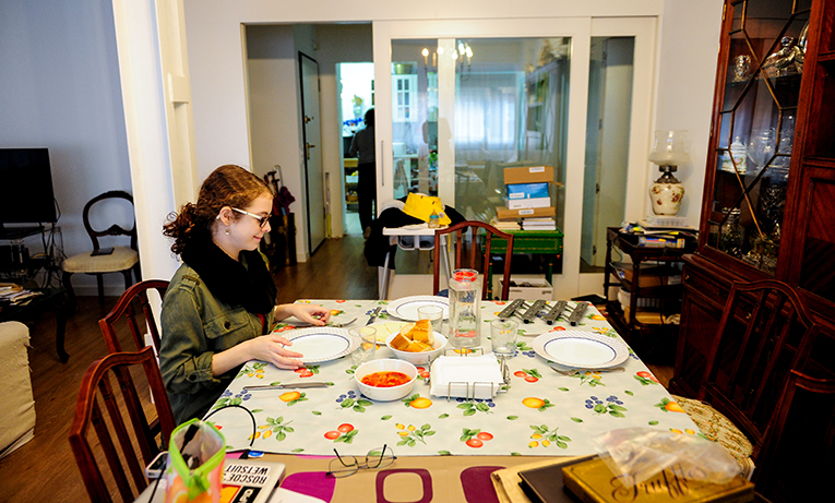 Exchange students sitting at her host family's dinner table