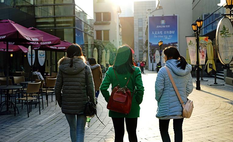 Girls walking in Shanghai Park, China