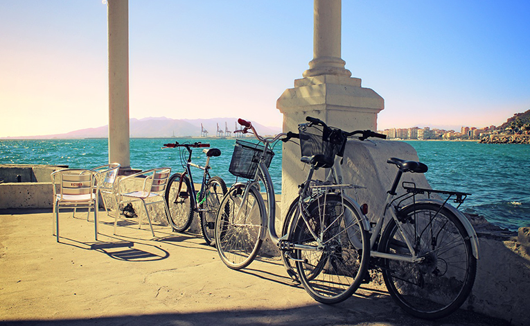 Biking along the Malaga harbor in Spain