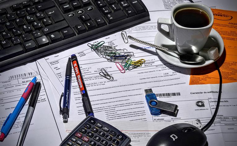 Bookkeeping office, messy desk.