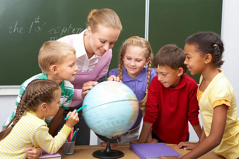 Teacher teaching the kids about the globe