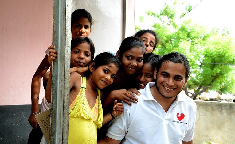 Male volunteer with children