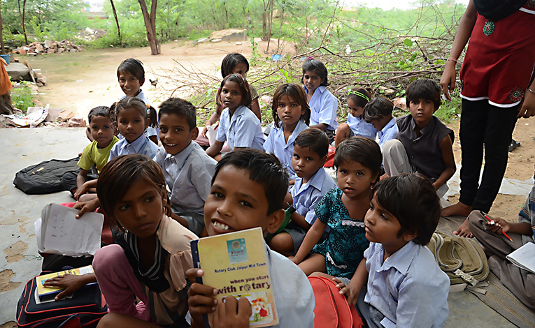 Children smiling at a school