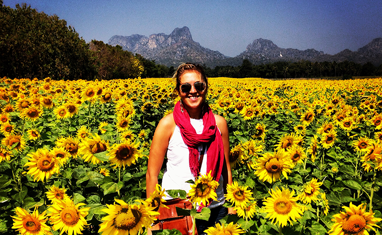 Girl in a sunflower patch in Thailand